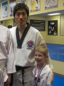 Dvh3 with Master Jung after his first belt test.